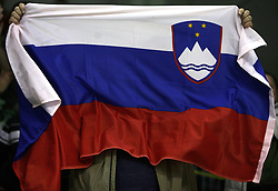 Fan of Olimpija has Slovenian flag in his hands at ice hockey match ZM Olimpija vs Liwest Linz in sixth round of semi-final of Ebel League (Erste Bank Eishockey Liga),  on March  9, 2008 in Arena Tivoli, Ljubljana, Slovenia. Win of ZM Olimpija 2:0, ZM Olimpija qualified in finals. (Photo by Vid Ponikvar / Sportal Images)