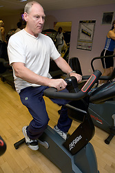 Man using upright fitness bike at Southglade Leisure Centre; Nottingham
