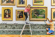 The return and re-hanging of the nation's Pre-Raphaelite works, including Millais' Ophelia (pictured right), to Tate Britain. They are going back on display from Thursday 7 August 2014 after being seen by over 1.1 million people worldwide. They include: John Everett Millais' , Ophelia; Beata Beatrix by Dante Gabriel Rossett (pictured left); The Lady of Shalott by John William Waterhouse; The Beloved by Rossetti; and Mariana (pictured centre) by John Everett Millais. These works are being displayed in the 'grand' surroundings of the 1840 galleries as part of the BP Walk through British Art. <br /> Millbank,  London, UK.