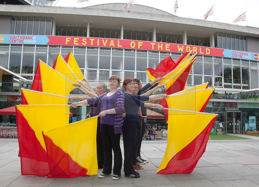 © Licensed to London News Pictures. 31/05/2012. London, England. Rehearsal for the semaphore flags message (Heart) to HM The Queen for the Thames Diamond Jubilee Pageant. Southbank Centre has commissioned Artist in Residence Lea Anderson to choreograph a new work - as the flotilla goes past Southbank Centre on 3 June, 30 dancers will be on the roof of the Royal Festival Hall to send HM The Queen a special message using semaphore flags in red and yellow. The message will spell out: Happy Diamond Jubilee Queen Elizabeth, We Heart Your. Photo credit: Bettina Strenske/LNP