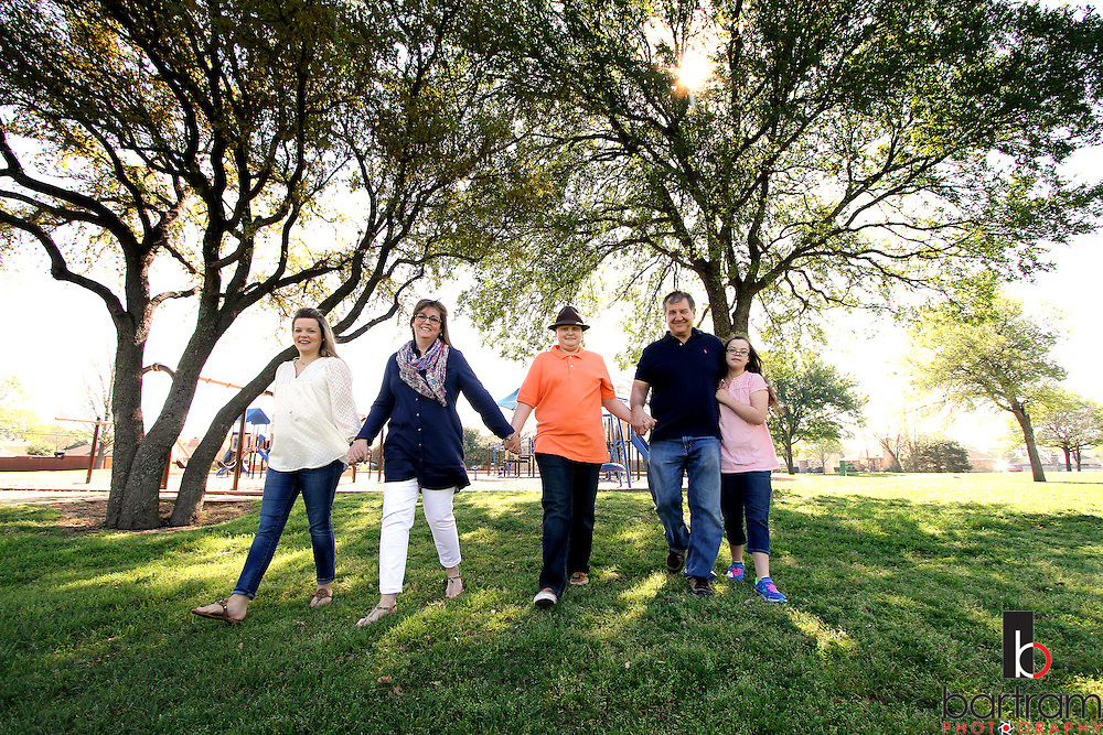 Jennifer Andrick, second from left, walks with her husband Tom Andrick  and her children Jessica Walker, Trevor Andrick and Allie Andrick on  Saturday, April 2, 2016 in Plano, Texas. (Photo by Kevin Bartram)