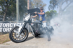 Commercial pilot Andrea Labarbara does a burnout on her Roland Sands RSD custom at the Perewitz Paint Show at the Broken Spoke Saloon during Daytona Beach Bike Week, FL. USA. Wednesday, March 13, 2019. Photography ©2019 Michael Lichter.
