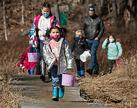 Remzey and Londynn Campione lead their group out the Gilford Nature Trail for the Bunny Hop and Story Walk put on by Gilford Parks and Recreation, Gilford Public Library and Gilford Community Center.  (Karen Bobotas Photo/for The Laconia Daily Sun)