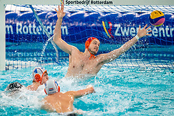 Eelco Wagenaar of the Netherlands in action against Enzo Khasz of France during the Olympic qualifying tournament. The Dutch water polo players are on the hunt for a starting ticket for the Olympic Games on February 17, 2021 in Rotterdam