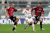 """Manolo Pestrin (Messina), Stefano Morrone (Livorno), Stefano Fiore (Livorno)<br /> Italian """"Serie A"""" 2006-07<br /> 18 Feb 2007 (Match Day 24)<br /> Livorno-Messina (2-1)<br /> """"Armando Picchi""""-Stadium-Livorno-Italy<br /> Photographer: Luca Pagliaricci INSIDE"""