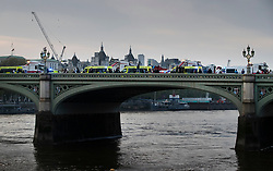 © Licensed to London News Pictures. 23/04/2020. London, UK. Ambulances line Westminster Bridge as their crews clap and cheer at 8pm for the weekly Clap for Carers celebration outside St Thomas' Hospital in central London. Lockdown continues throughout the UK in an attempt to stop the spread of the coronavirus Covid-19 virus. Photo credit: Peter Macdiarmid/LNP