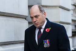 © Licensed to London News Pictures. 10/11/2019. London, UK. Defence Secretary Ben Wallace walks through Downing Street to attend the Remembrance Sunday Ceremony at the Cenotaph in Whitehall. Remembrance Sunday events are held across the country today as the UK remembers and honours those who have sacrificed themselves in two world wars and other conflicts. Photo credit: Vickie Flores/LNP