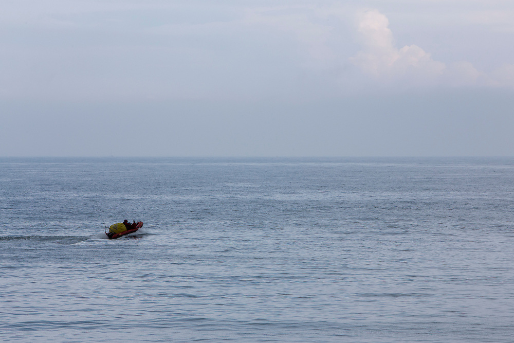 A small orange rigid hulled inflatable (RIB) boat sails out across the calm English Channel from Folkestone, Kent, England, United Kingdom. (photo by Andrew Aitchison / In pictures via Getty Images)