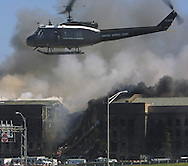A  8 MG IMAGE OF:.Arlington,VA 9/11/01 An Army medivac helicopter  takes off from the Pentagon parking lot with the burning Pentagon in background, photo by Dennis Brack