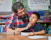 John Augustine works math problems with his students at Sinclair Elementary School, April 15, 2014.