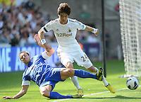 Swansea City's Ki Sung-Yong  battles with Everton's Phil Jagielka ..Football - Barclays Premiership - Swansea City v Everton - Saturday 22nd September 2012 - Liberty Stadium - Swansea..