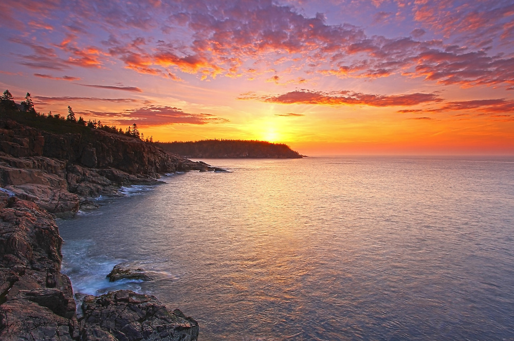 Acadia Magic – Sunrise Maine Acadia National Park coastal photography images are available as museum quality photography prints, canvas prints, acrylic prints or metal prints. Prints may be framed and matted to the individual liking and room decor needs:<br /> <br /> http://juergen-roth.pixels.com/featured/acadia-magic-juergen-roth.html<br /> <br /> Stunning sunrise seacoast photography showing a spectacular vista across the beautiful cliffs of the Maine rocky coastal shoreline in Acadia National Park. <br /> Acadia NP is a National Park located in the U.S. state of Maine. It reserves much of Mount Desert Island, and associated smaller islands, off the Atlantic coast. The park is one of the most visited wildlife areas in the United States and a paradise for every photographer and outdoor enthusiast. The park loop road provides easy access to many of the iconic photography subjects, such as Monument Cove, Sand Beach, Jordan Pond and the Bubbles, Otter Cliff to name only a few. The carriage roads and hiking trails provide further access to more remote locations where the park continues to inspire and unfolds its full magic. It is a heaven for macro, seascape, and landscape photography that makes for great wall art decoration. Especially sunrise and the light of the golden hours paint the sky in beautiful blue and orange and bring out the beauty of the pink granite rocks.<br /> <br /> Good light and happy photo making! <br /> <br /> My best, <br /> <br /> Juergen <br /> Website: www.RothGalleries.com<br /> Twitter: @NatureFineArt<br /> Facebook: https://www.facebook.com/naturefineart<br /> Instagram: https://www.instagram.com/rothgalleries