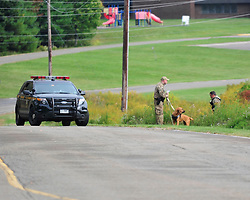 Police converge on Barrett Township in the Pocono Mountains in search of ambush suspect Eric Matthew Frein who is accused of shooting two Pennsylvania State Troopers Sept. 25th, 2014 in Canadensis, Pennsylvania (Chris Post | lehighvalleylive.com)