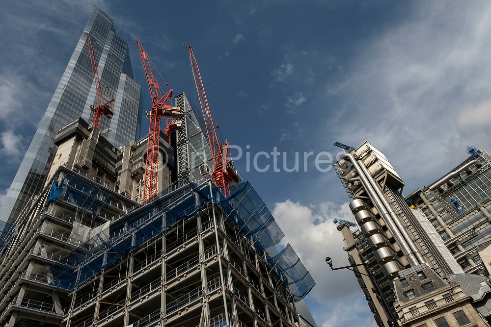 View looking up at the construction site for the latest skyscraper in the City of London at 8 Bishopsgate on 2nd July 2021 in London, United Kingdom. As the coronavirus lockdown continues its process of easing restrictions, the City remains far quieter than usual, which asks the question if normal numbers of people and city workers will ever return to the Square Mile.