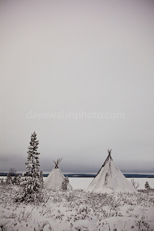 """Two traditional Saami tents, or Lavvu - typical of reindeer herding peoples - on the shore of the frozen lake Muddusjarvi, near Inari, Lapland, Finland. Taken at 3am with some moonlight, 30"""" exposure, December 2011. This mage can be licensed via Millennium Images. Contact me for more details, or email mail@milim.com For prints, contact me, or click """"add to cart"""" to some standard print options."""