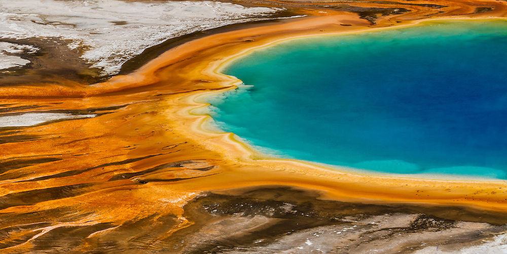 The elevated hillside view of Grand Prismatic Spring in Yellowstone National Park provides a unique view down onto the spring's vividly colored rings.