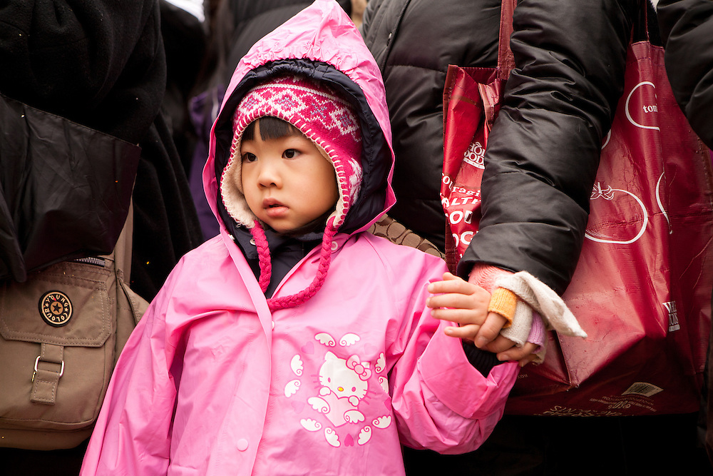 Young spectator watching the ceremonies.