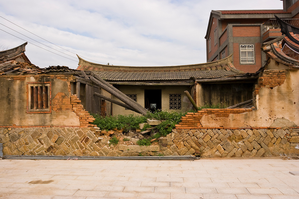 Damaged traditional southern Chinese housing on Kinmen, Republic of China ROC (Taiwan). ..Kinmen (Jinmen) formely known as Quemoy. The island lies less than 2km off the coast of China, and in 1949 was turned into a front-line of defense for Taiwan by Chiang Kai-shek and the Chinese nationalist Kuomintang (KMT) in the ongoing war with the communist PRC. The island existed under martial law until 1993. Today, Kinmen is a popular tourist destination and home to a lot of traditional Fujian-style architecture.