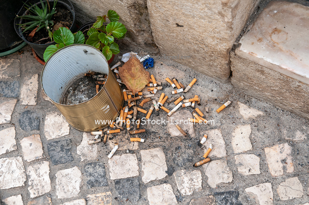 A pile of cigarette butts on the floor