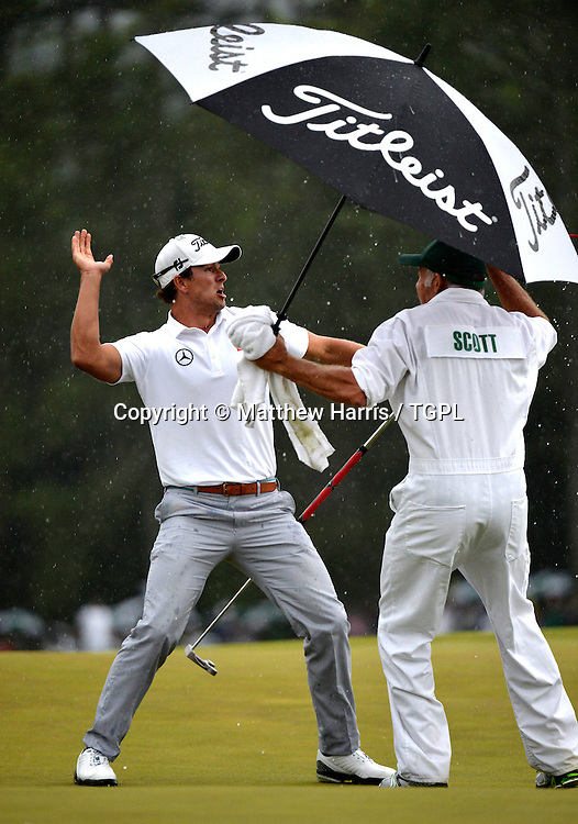 Adam SCOTT (AUS) reacts to making birdie at 18th par 4 to get into play off with Angel CABRERA (ARG) during fourth round,US Masters 2013,Augusta National,Augusta,Georgia,USA.
