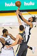 San Antonio Spurs guard Patty Mills (8) shoots over Golden State Warriors guard Klay Thompson (11) during Game 2 of the Western Conference Quarterfinals at Oracle Arena in Oakland, Calif., on April 16, 2018. (Stan Olszewski/Special to S.F. Examiner)