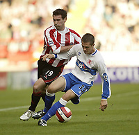 Photo: Aidan Ellis.<br /> Sheffield United v Middlesbrough. The Barclays Premiership. 30/09/2006.<br /> Boro's Andrew Taylor holds off Sheffield's Keith Gillespie (L)