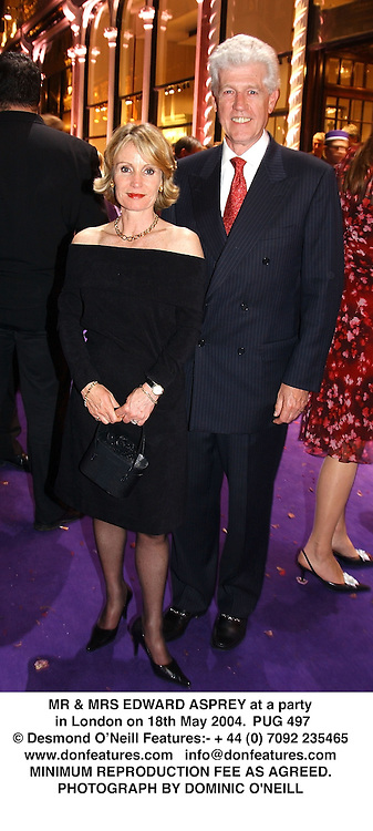 MR & MRS EDWARD ASPREY at a party in London on 18th May 2004.PUG 497