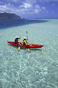 Couple kayaking, Kaneohe Bay, Oahu, Hawaii<br />