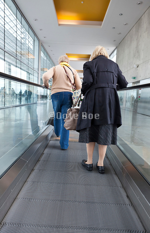 senior people at the end of a Conveyor belt at Blagnac airport in Toulouse, France
