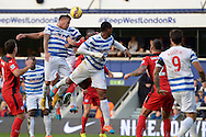 Eduardo Vargas of Queens Park Ranger attempting to head the ball from a corner kick. Barclays Premier league match, Queens Park Rangers v Leicester city at Loftus Road in London on Saturday 29th November 2014.<br /> pic by John Patrick Fletcher, Andrew Orchard sports photography.