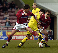 Picture: Henry Browne.<br />Date: 09/04/2005.<br />Northampton Town v Scunthorpe United Coca-Cola League 2.<br />Matthew Sparrow of Scunthorpe is challenged by Charly Hearn of Northampton.