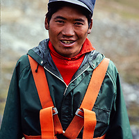Ang Dyale Sherpa in his climbing harness at an early mountaineering school for sherpas in the Khumbu region of Nepal, 1980.