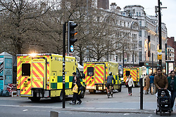 © Licensed to London News Pictures . 06/04/2017 . Manchester , UK . Three ambulances visible (and a further two rapid response vehicles and a bicycle paramedic) lined up in Piccadilly Gardens , responding to numerous instances of people believed to have consumed spice . An epidemic of abuse of the drug spice by some of Manchester's homeless population , in plain sight , is causing users to experience psychosis and a zombie-like state and is daily being witnessed in the Piccadilly Gardens area of Manchester , drawing large resource from paramedic services in the city centre . Photo credit : Joel Goodman/LNP