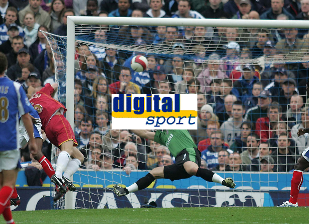 Photo: Lee Earle.<br /> Portsmouth v Reading. The Barclays Premiership. 28/10/2006. Reading's Bryjar Gunarsson (L) is pressurised by Portsmouth's Kanu and scores against his own keeper Marcus Hahnemann.