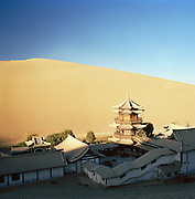 Temple complex at the Singing Sand Dunes, Silk Route, Dunhuang, Jiuquan, Gansu Province, China.