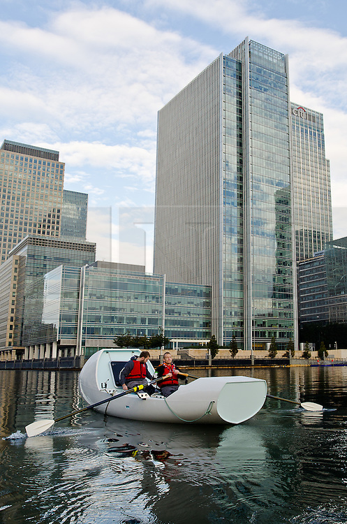 © Licensed to London News Pictures. 11/10/2014. London, UK. [NB STRICT EMBARGO - no use until 00:01 12/10/14 ]Making a splash: Scout volunteer living with epilepsy, Ashley Wilson, and Scout Ambassador and adventurer James Ketchell, test their specially designed 'Nothing's Impossible' boat for the first time in the docks around London's Canary Wharf. Photo credit : Ian Homer/LNP