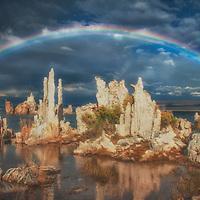Full rainbow over tufa formations at Mono Lake, California.