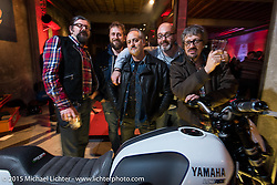 Giuseppe Roncen and his LowRide Magazine crew including Danilo Seclì, Lorenzo Rinaldi and Aldo Pagnussat at the Yamaha party during EICMA, the largest international motorcycle exhibition in the world. Milan, Italy. November 17, 2015.  Photography ©2015 Michael Lichter.