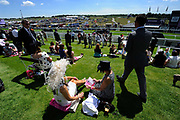 Derby Day at Epsom Downs Racecourse, United Kingdom. The Derby Stakes, popularly known as The Derby, is a Group 1 flat horse race in England open to three-year-old thoroughbred colts and fillies. It is run at Epsom Downs Racecourse in Surrey over a distance of one mile, four furlongs and 10 yards 2,423 metres, in early June each year.