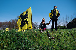 Flandrian flags well represented on the course - Women's Ronde van Vlaanderen 2016. A 141km road race starting and finishing in Oudenaarde, Belgium on April 3rd 2016.