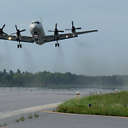 BRUNSWICK, Maine -- May 31, 2011-- A P-3 Orion aircraft from Patrol Squadron 26, based at Jacksonville, Fla. lifts off from NAS Brunswick Maine after visiting its former home base on Tuesday. Participating in disestablishment ceremonies as a static display, it was the final time that a P-3 landed and took off from the base. .Naval Air Station Brunswick Maine, opened in 1943 as a training area for British pilots and home to many squadrons of P-3 Sailors, disestablished today in a ceremony at the command building. (U.S. Navy Photo by Mass Communication Specialist Seaman Ty Connors / Released)