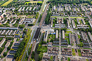 Nederland, Zuid-Holland, Rotterdam, 15-07-2012; Rechts Pendrecht, links van de Zuiderparkweg Zuidwijk (deelgemeente Charlois, Rotterdam-Zuid). Metrostation Slinge..Nieuwbouwwijk uit de jaren vijftig van de vorige eeuw, wederopbouw periode. Stedenbouwkundig ontwerp van Lotte Stam-Beese, kenmerkend zijn de ruime opzet en  veel groen. Ontworpen als wijk met verschillende woningtypen (en verschillende bewoners) en voorzien van alle voorzieningen..Pendrecht (part of Charlois, Rotterdam-South). New neighborhood (fifties of the last century), post-war reconstruction period. Urban design of Lotte Stam-Beese, characterized by spacious layout and lots of green. Designed as residential district with different housing types.. .QQQ.luchtfoto (toeslag), aerial photo (additional fee required).foto/photo Siebe Swart