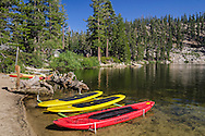 Boats and paddleboards on beach at Angora Lakes, Eldorado National Forest, near South Lake Tahoe, California