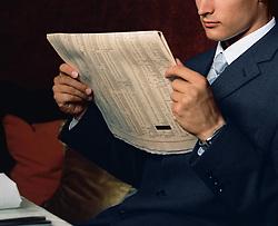 Dec. 14, 2012 - Businessman reading financial paper (Credit Image: © Image Source/ZUMAPRESS.com)