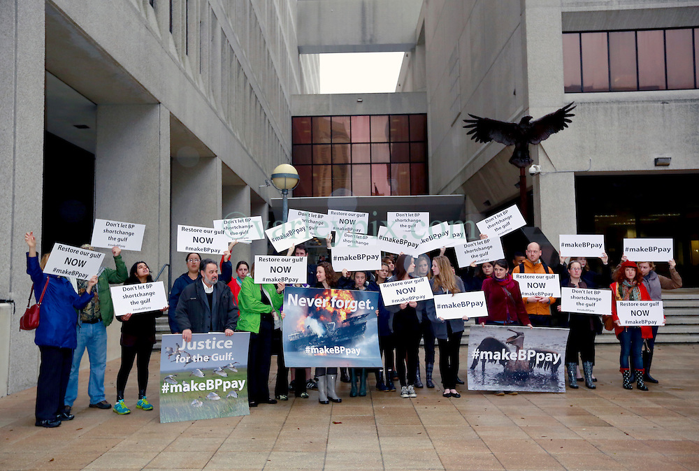 25 February 2013. New Orleans, Louisiana,  USA. .BP Trial. Protesters gather outside the Hale Boggs Federal Courthouse in the early morning drizzle for the opening day of the BP trail  at the New Orleans Federal Courthouse..Photo; Charlie Varley.