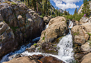 Shadow Creek exits Shadow Lake in a series of falls in Ansel Adams Wilderness, Inyo National Forest, near Mammoth Lakes, California, USA. Hike to Shadow Lake (7.5 miles, 1200 ft gain). Multiple overlapping photos were stitched to make this panorama.