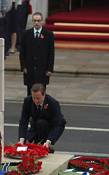 (c) London News Pictures. 14/11/2010.  Prime Minister David Cameron laying a wreath at the foot of the Cenotaph today (Sun) during a remembrance service to honour of those who have died in wars and conflicts. Picture credit should read: Will Oliver/London News Pictures