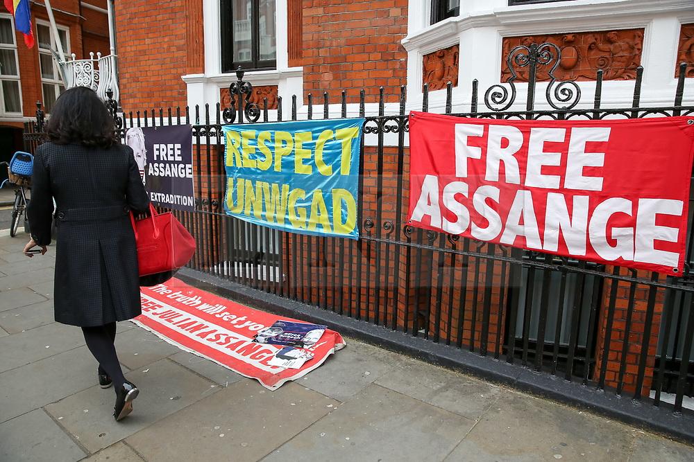 © Licensed to London News Pictures. 05/04/2019. London, UK. A woman walks past large banners outside Ecuadorian Embassy in Knightsbridge. Media reports state that the Ecuadorian Embassy plan to remove Julian Assange, Wikileaks founder from the embassy within days. Julian Assange claimed political asylum in the Ecuadorean Embassy in June 2012 after he was accused of rape and sexual assault against women in Sweden. Photo credit: Dinendra Haria/LNP
