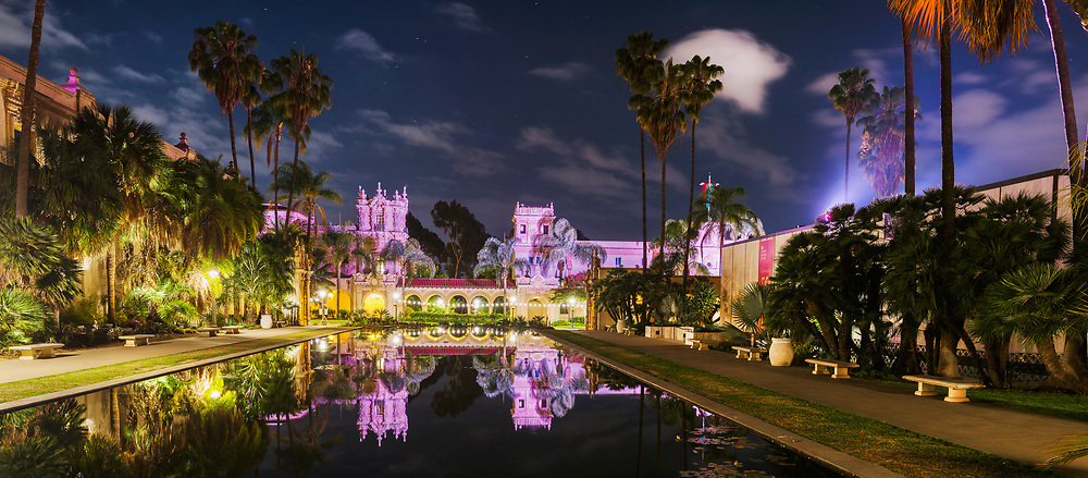 The Lily Pond and El Prado Arcade are seen under a cool summer night sky in San Diego, CA. The lily pond lies adjacent to the Botanical Building, one of the largest lath structures in the world. The pond, one of the most photographed landmarks in San Diego, was created for the Panama-California Exposition of 1915 in San Diego's Balboa Park. Brought about with the aim of highlighting San Diego as the first U.S. port of call for ships traveling north after passing westward through the newly opened Panama Canal, the exposition occurred at the same time as the larger Panama-Pacific International Exposition in San Francisco. Nonetheless, the fair was widely regarded as a success, with over two million visitors by the end of 1915 and just under 1.7 million attendees in its second year (due to it's success, the fair was extended from its original one year duration). <br /> <br /> As was customary of world's fair's of that era, the attractions and structures of the Panama-California exposition were constructed with cheap, temporary materials with the intention of being demolished once the fair had ended. However, Many notable visitors including Teddy Roosevelt advocated for the preservation of the immaculate structures. As a result, many of the fair's buildings and gardens were renovated or reconstructed with permanent building materials in order to ensure their enjoyment by future generations.