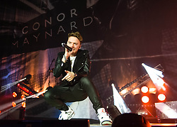 © Licensed to London News Pictures. 05/12/2013. London, UK.   Conor Maynard performing live at The O2 Arena, supporting headliner Will.i.am.  Conor Maynard is an English singer-songwriter from Brighton & Hove.  Photo credit : Richard Isaac/LNP